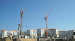 Construction cranes work at construction site Stock Footage