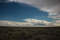 Timelapse of daytime clouds over wide expanse of prairie Stock Footage