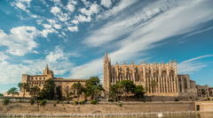 Timelapse with flying clouds over Cathedral of Palma de Mallorca and Almudaina Stock Footage