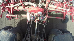 Tractor with sowing machine planting seeds - stock footage