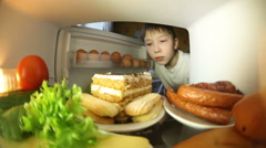 The family looks in the fridge . Everyone chooses for himself the products. Stock Footage