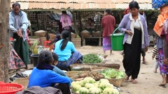Burmese people buy and sell products on the street food market, Myanmar Stock Footage