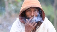 Portrait beggar who smokes a cigarette in street , Myanmar. Burma Stock Footage