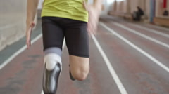 Determined Amputee Athlete Running a Race - stock footage