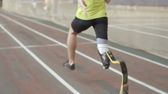 Amputee Athlete Running in Practice - stock footage