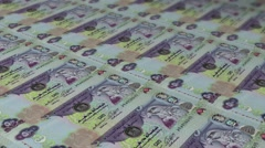 UAE 500 Dirham currency sheets being printed and stacked up Stock Footage