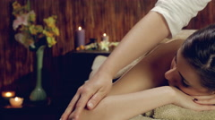 Dolly shot of woman getting back massage in spa 4K closeup retro style Stock Footage