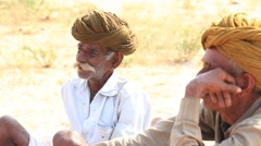 Indian men attended the annual Pushkar Camel Mela.  India Stock Footage
