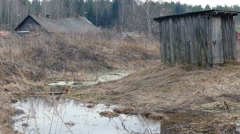 Spring Water and Dilapidated Rural Houses. - stock footage