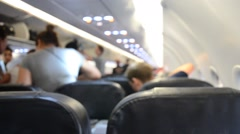 Passenger walking out of plane - stock footage
