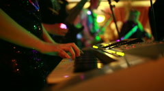 Girl playing on a synthesizer in a club. people are dancing Stock Footage