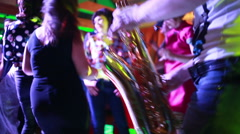 Saxophonist playing for dancing people Stock Footage