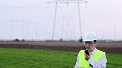 Engineer talks on a walkie talkie - stock footage