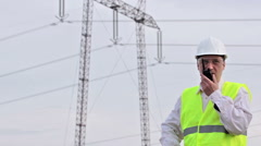 Worker control transmission line - stock footage