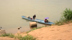Laotian people rowing wooden boat at mekong river Stock Footage