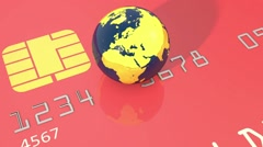 Closeup of spinning earth globe on credit card - stock footage
