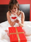 Valentine's card in bed - stock photo