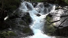 Waterfall on the mountain river, bouncing over boulders gray Stock Footage
