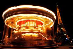 Carousel near Eiffel Tower - stock photo