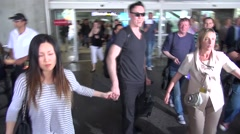 Kevin Durand arriving in Cannes with his wife Stock Footage