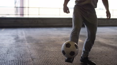 Handheld shot of soccer freestyle player doing tricks with the football Stock Footage