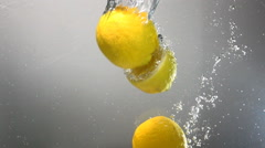 Whole lemon drops under water. Isolated - stock footage