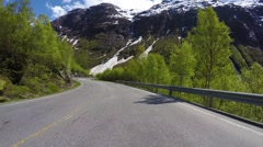 Driving a car on a serpentine road in Norway Stock Footage