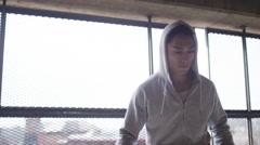 Handheld shot of hooded asian man doing football skills Stock Footage