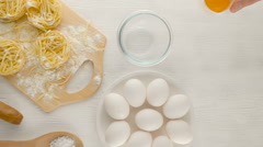 Eggs with flour on white wood background, top view Stock Footage