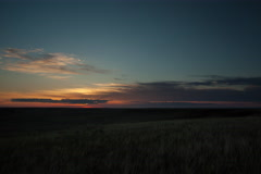 Timelapse of sun rising over wide expanse of grass prairie Stock Footage