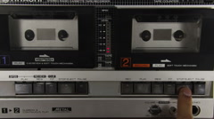 Insert Audio Cassettes into the Tape Player and Pushing Play, Stop Buttons Stock Footage