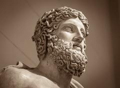 Head and shoulders detail of the ancient sculpture - stock photo