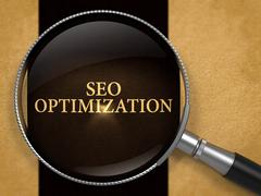 SEO Optimization through Loupe on Old Paper - stock illustration