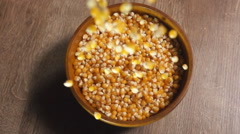 Pop corn pouring into a bowl Stock Footage