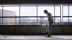 Football player doing fancy kick up tricks with a soccer ball - stock footage