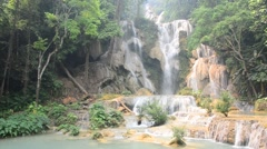 Kuang Si Falls or Tat Kuang Si Waterfalls Stock Footage