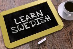 Hand Drawn Learn Swedish Concept on Chalkboard - stock illustration