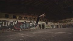 Dolly Shot Tumbling in Abondoned Factory Stock Footage