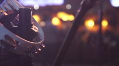 Defocused people dancing in a nightclub. Tambourine hanging in the foreground. - stock footage