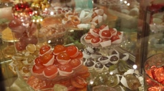 Sweets in a glass dish on display. Stock Footage