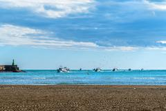 Boats returning from fishing to the port Stock Photos