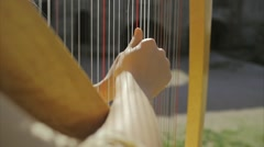 Girl plays harp Slowmotion Stock Footage