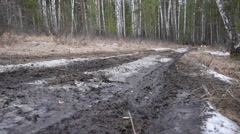 Riding a quad bike in the mud - stock footage