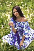 Beautiful girl with brown eyes in a gown, sexy outdoors. Fashion dress flowers Stock Photos