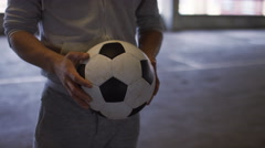 Determined young man keeps the football in the air using his head alone Stock Footage
