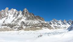 A group of skiers look at Leschaux Glacier, in the Mont Blanc massif - stock photo