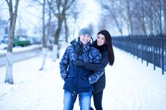 Beautiful adult couple love, park in winter Stock Photos