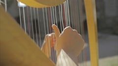 Slowmotion Harp played by Girl medevil Stock Footage
