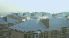Smoke comes out of pipes of multi-storey building Stock Footage