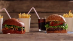 Burgers with beverages and fries. - stock footage